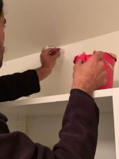 handyman painting a room